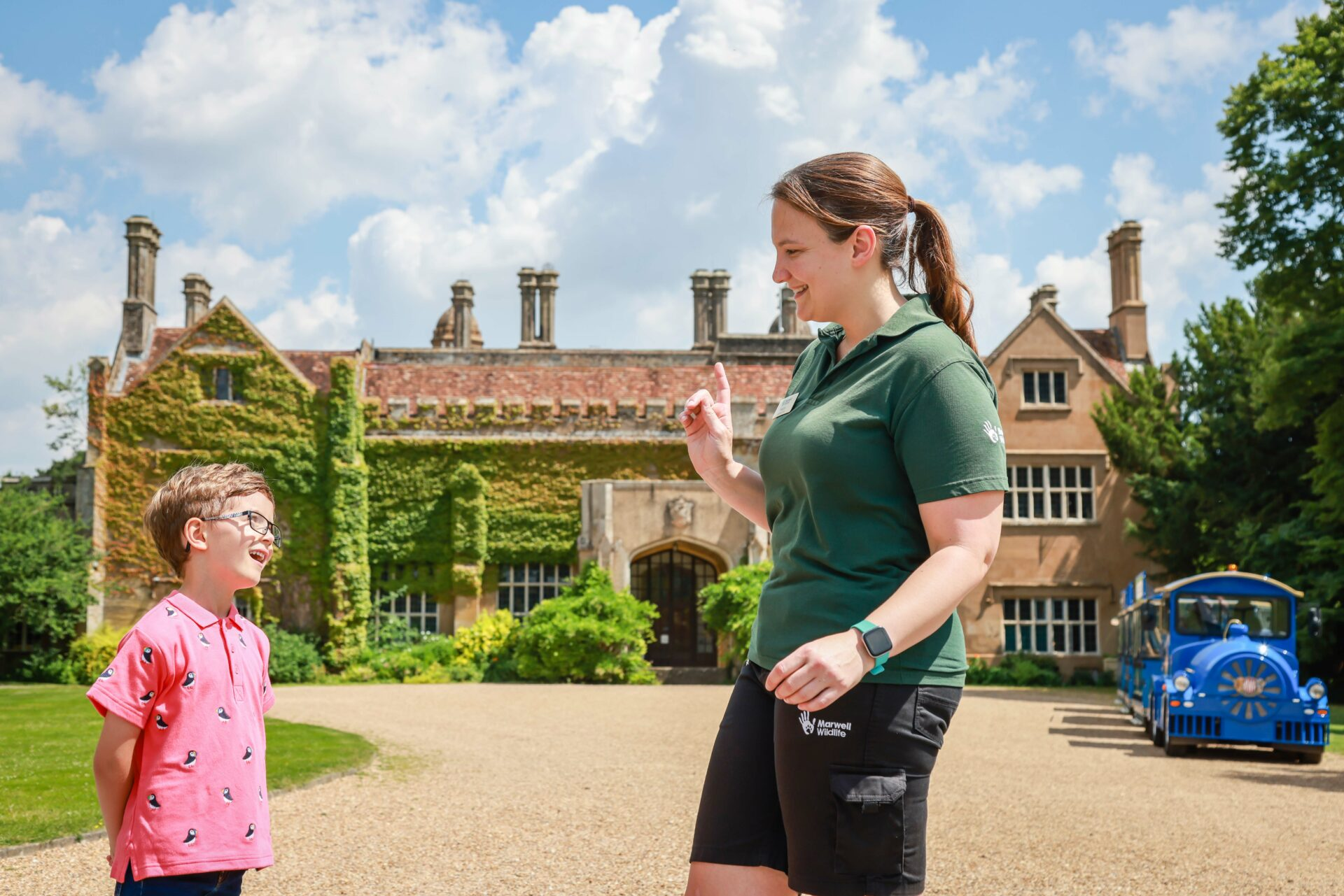 Boy and staff member outside Marwell Hall